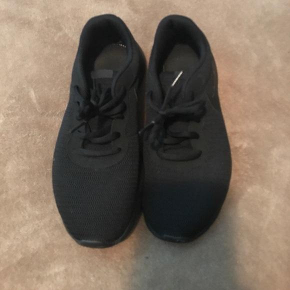 All black nike tanjun sneakers